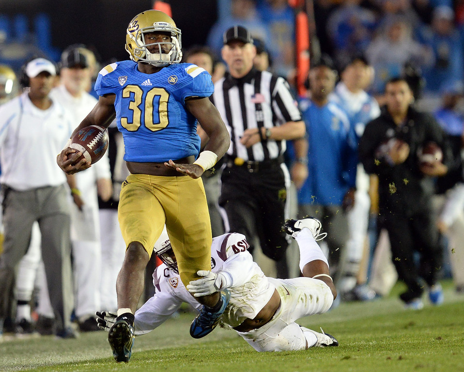 . UCLA�s Myles Jack #30 heads up field  during their game against Arizona State at the Rose Bowl Saturday November 23, 2013. (Photos by Hans Gutknecht/Los Angeles Daily News)