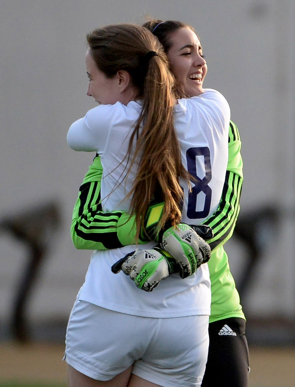 . Diamond Bar\'s Victoria Phinney (38) hugs goal keeper Stevie Eide after defeating Bishop Amat 3-2 during a CIF-SS second round prep playoff soccer match at Diamond Bar High School in Diamond Bar, Calif., on Wednesday, Feb.26, 2014.
