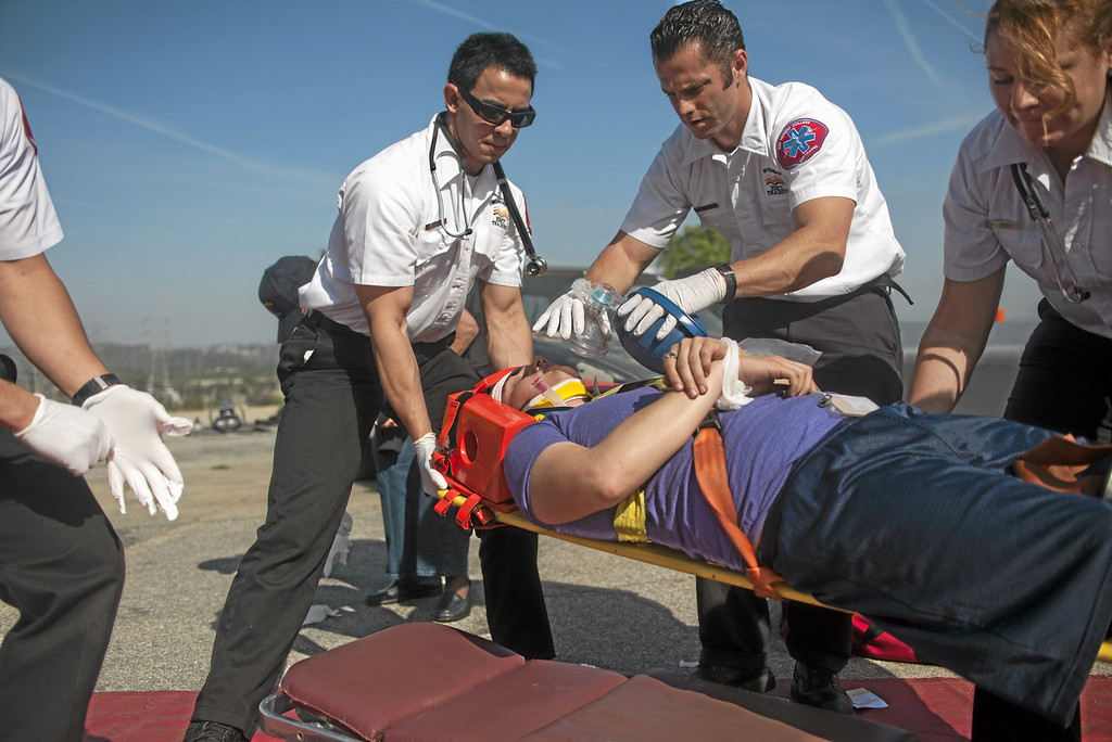. Theater student Angel Gutierrez, on the stretcher, acts as a car crash victim during a crisis drill at Rio Hondo College in Whittier on Friday, May 9, 2014. (Correspondent Photo by William Camargo)
