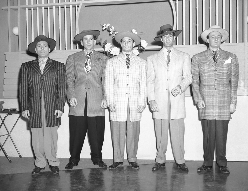 """. \""""Zoot\"""" gangsters, are portrayed by actors in a movie being made at Universal Studios, in Los Angeles, Calif., March 4, 1943. The War Production Board had banned the sale of zoot suits because they required the use of more material than the average suit, but an exception was made for the film. (AP Photo)"""