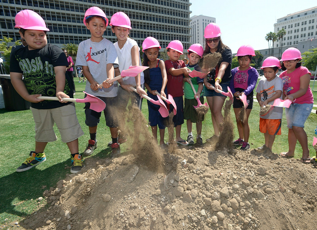 . Children from Casa Cultura Saybrook Park in Los Angeles  break ground for Grand Park�s innovative new play area.  The play area is slated to open in November 2014.  Los Angeles, CA. 7/30/2014(Photo by John McCoy Daily News)