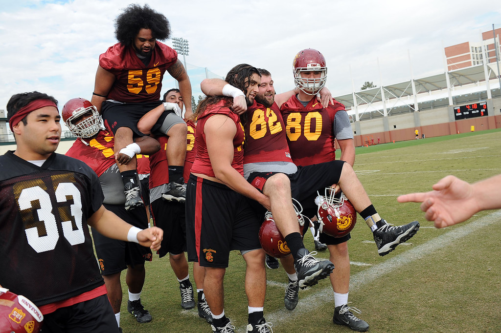 . Players are carries off the field at the conclusion of USC\'s final practice of the 2013 season December 18, 2013 in Los Angeles, CA.  The team flies to Las Vegas to play Fresno State in the Las Vegas Bowl on December 21, 2013.(Andy Holzman/Los Angeles Daily News)