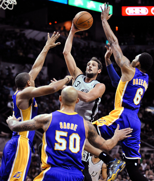 . San Antonio Spurs guard Marco Belinelli shoots between Los Angeles Lakers, from left, Xavier Henry, Robert Sacre and Kent Bazemore during the first half of an NBA basketball game Friday, March 14, 2014. (AP Photo/Bahram Mark Sobhani)