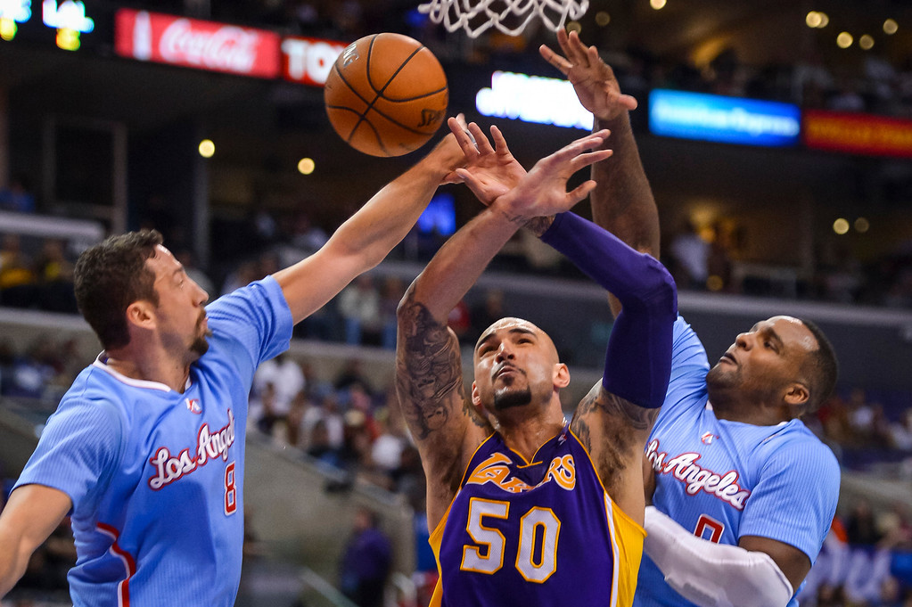. Clippers Hedo Turkoglu and Glen Davis and Lakers� Robert Sacre go for a rebound during game action at Staples Center Sunday April 6, 2014. Clippers defeated the Lakers 120-97.  ( Photo by David Crane/Los Angeles Daily News )