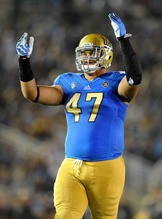 . UCLA defensive lineman Eddie Vanderdoes pumps up the crowd in the third quarter against Colorado, Saturday, November 2, 2013, at the Rose Bowl. (Photo by Michael Owen Baker/L.A. Daily News)