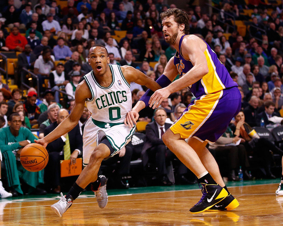 . BOSTON, MA - JANUARY 17: Avery Bradley #0 of the Boston Celtics drives to the basket past Pau Gasol #16 of the Los Angeles Lakers in the first quarter during the game at TD Garden on January 17, 2014 in Boston, Massachusetts.   (Photo by Jared Wickerham/Getty Images)