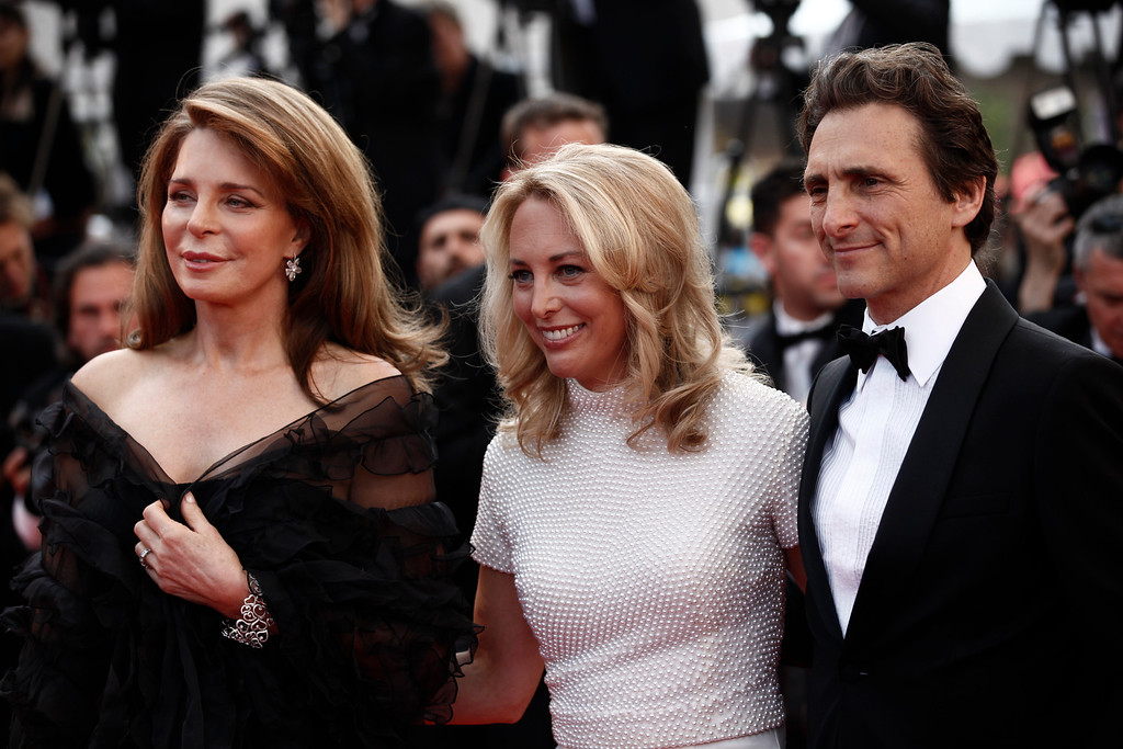 ". From left, Queen Noor of Jordan, Lawrence Bender and Valerie Plame Wilson arrive for the screening of ""Biutiful\"", at the 63rd international film festival, in Cannes, southern France, Monday, May 17, 2010. (AP Photo/Matt Sayles)"