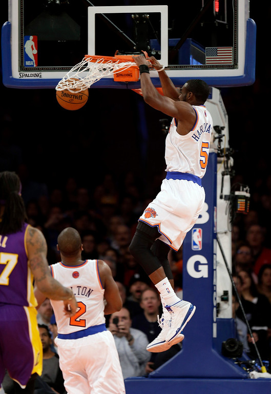 . New York Knicks\' Tim Hardaway Jr. finishes off an alley-oop during the second half of an NBA basketball game against the Los Angeles Lakers at Madison Square Garden, Sunday, Jan. 26, 2014, in New York. The Knicks won 110-103. (AP Photo/Seth Wenig)