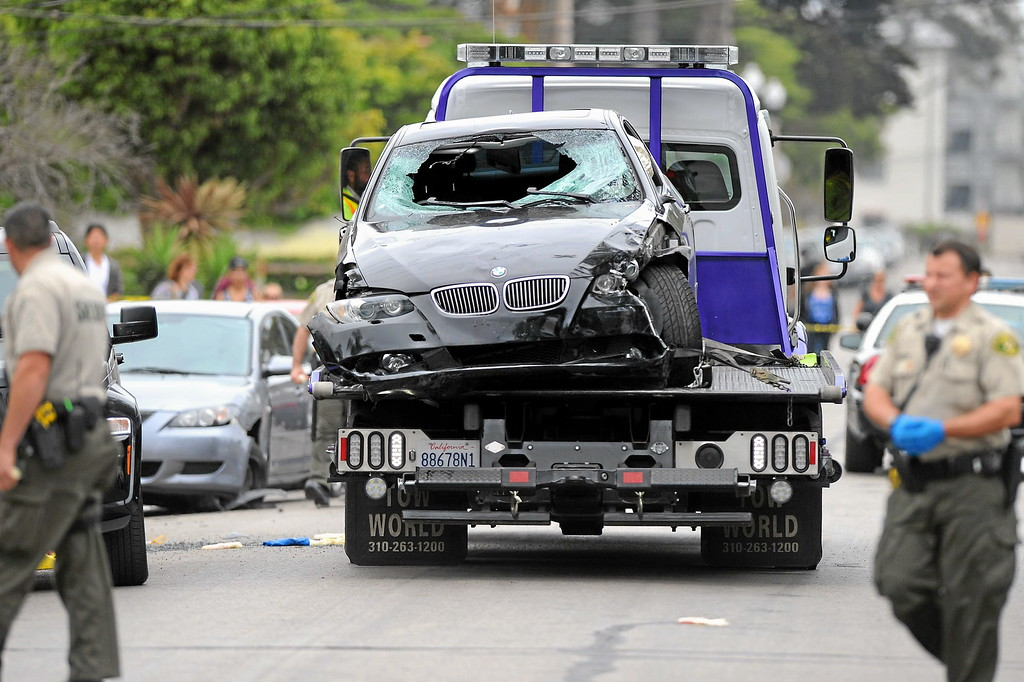 . The gunman\'s car is loaded onto a tow truck on Del Playa Drive in Isla Vista, Saturday, May 24, 2014. (Photo by Michael Owen Baker/Los Angeles Daily News)