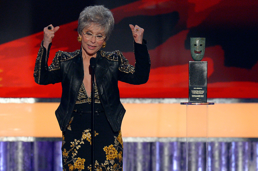 . Rita Moreno reacts while on stage being honored at the 50th recipient SAG Life Achievement Award during the show of the 20th Annual Screen Actors Guild Awards  at the Shrine Auditorium in Los Angeles, California on Saturday January 18, 2014 (Photo by Andy Holzman / Los Angeles Daily News)