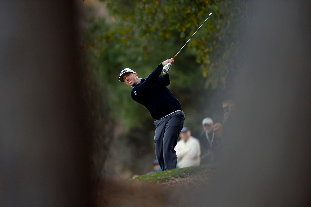. Hunter Mahan hits his approach shot on the 18th during the second round of the Northwestern Mutual World Challenge golf tournament at Sherwood Country Club, Friday, December 6, 2013, in Thousand Oaks, Calif. (Andy Holzman/Los Angeles Daily News)