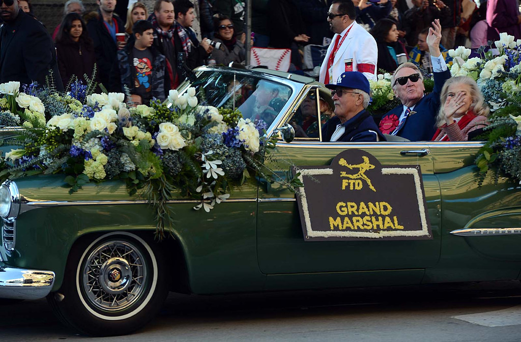 . Vin Scully, Dodger\'s hall of fame broadcaster, waves to crowds along Colorado Blvd in Pasadena during the Rose Parade. Today\'s Rose Parade, Wednesday January 1, 2014, marks the iconic parade\'s 125th year along the streets of Pasadena, CA. (Staff photo by Rick Sforza/Pasadena Star-News)