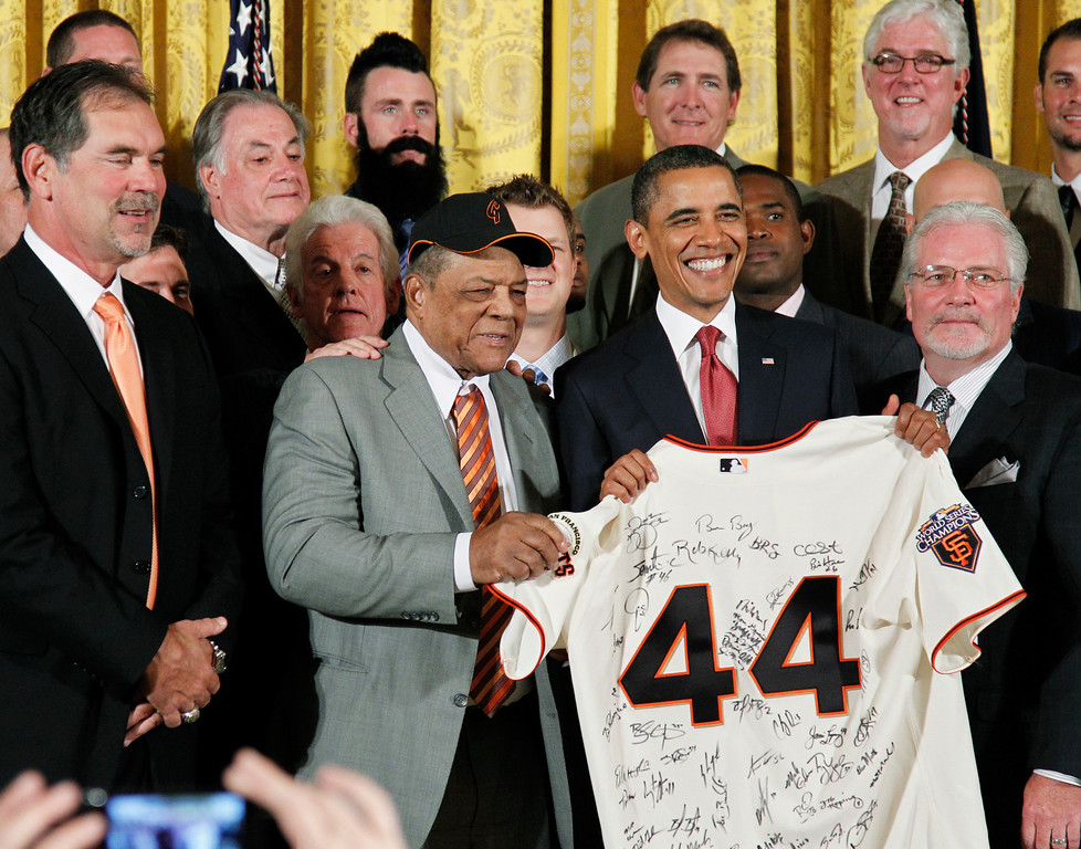 . President Barack Obama and Major League Baseball hall of famer Willie Mays, hold up an autographed San Francisco Giants jersey presented to the president by San Francisco Giants manager Bruce Bochy, left, as he honored the 2010 World Series baseball champions during a ceremony in the East Room of the White House in Washington, Monday, July 25, 2011. Others are General Manager Brian Sabean, right, and pitcher Brian Wilson, center, rear. (AP Photo/Manuel Balce Ceneta)