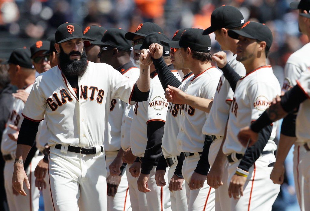 . San Francisco Giants pitcher Brian Wilson (38), left, is shown before a baseball game against the Pittsburgh Pirates in San Francisco, Friday, April 13, 2012. (AP Photo/Jeff Chiu)