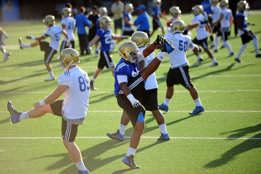 . UCLA players stretch on the final day of spring practice Thursday, April 24, 2014.(Andy Holzman/Los Angeles Daily News)