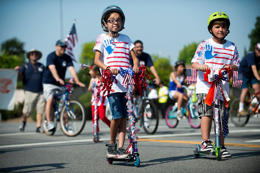 . I Love America parade rolls down Stimson Avenue in Hacienda Heights on Thursday, July 4, 2013. (SGVN/Staff photo by Watchara Phomicinda)