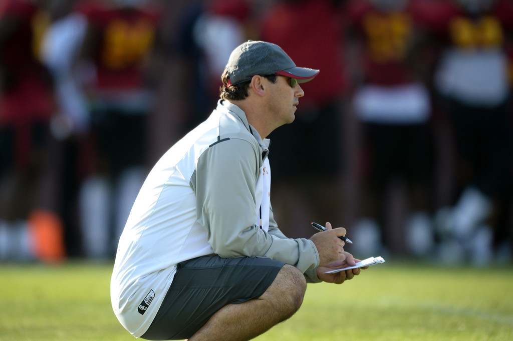 . USC head coach Steve Sarkisian watches practice with notes in hand, Thursday, March 27, 2014, at USC. (Photo by Michael Owen Baker/L.A. Daily News)