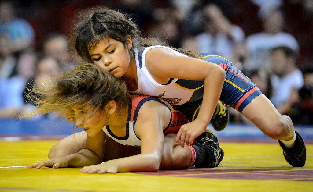 . Patricia Arana,9, of Pacoima, red, and Viviana Garcia, 9, of San Fernando wrestle during their match at the USA vs Russia vs Canada dual meet at the Sports Arena Sunday .  Photo by David Crane/Los Angeles Daily News.