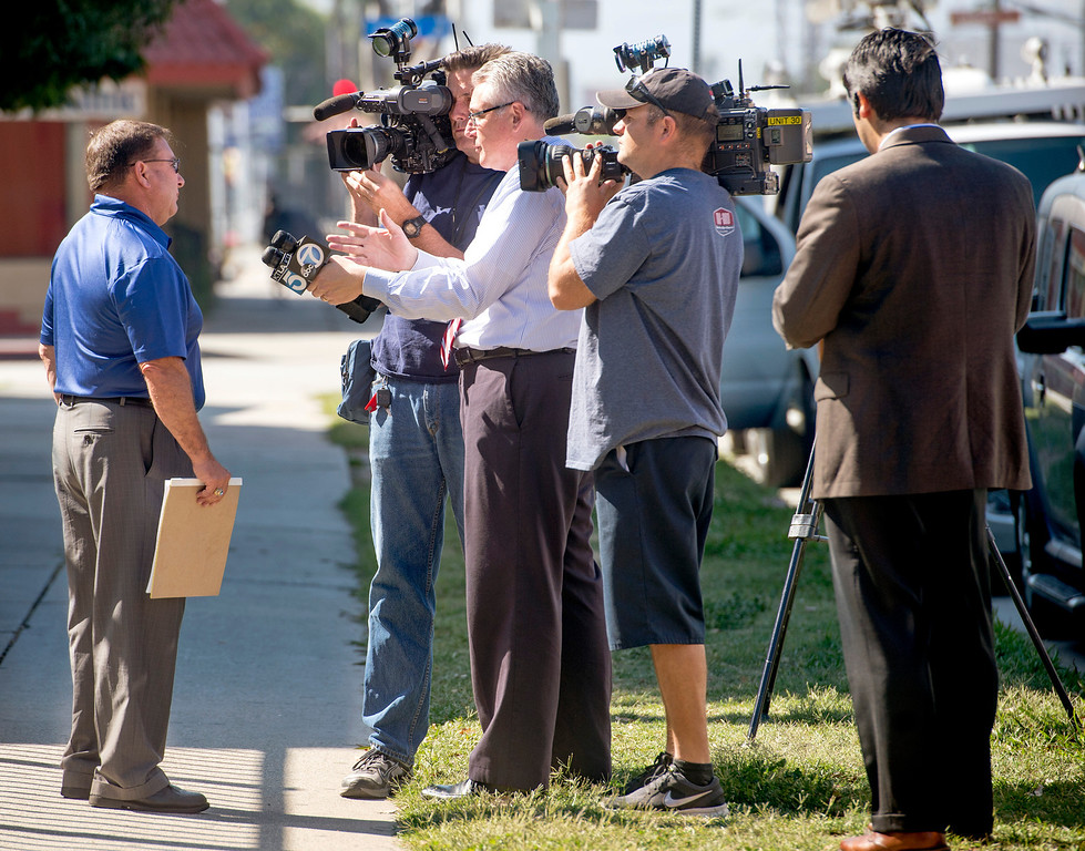 . El Monte Union High School District superintendent Nick Salerno talks to news media outside the El Monte High campus after two female classmates were hospitalized and a male student is unaccounted for when a bus carrying students to a Humbolt State University campus tour collided head on with a FedEx big rig in Northern California April 10, 2014.  (Staff photo by Leo Jarzomb/San Gabriel Valley Tribune)