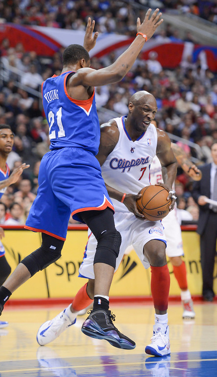 . Clippers\' Lamar Odom gets a rebound from Philadelphia\'s Thaddeus Young during first half action at Staples Center Wednesday.   (Photo by David Crane/Los Angeles Daily News)