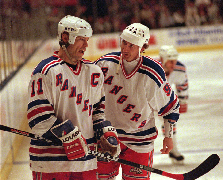 . New York Rangers Mark Messier, left, and Wayne Gretzky plan their moves as they wait for a face off in the second period Tuesday, May 20, 1997 against the Philadelphia Flyers at Madison Square Garden in New York. The Flyers won 6-3 to take a 2-1 lead in the Eastern Conference Finals. (AP Photo/Ron Frehm)
