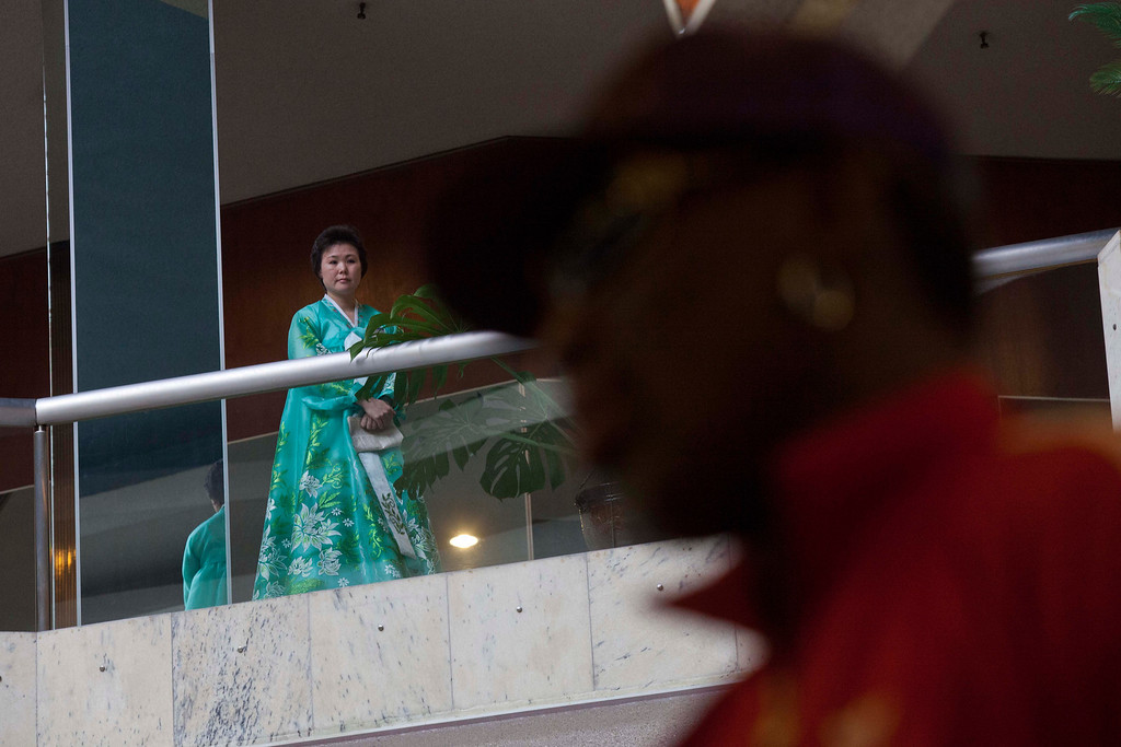 . A North Korean woman looks down from a balcony as Dennis Rodman arrives at his hotel in Pyongyang, North Korea after a morning practice session on Wednesday, Jan. 8, 2014. Rodman came to the North Korean capital with a team of USA basketball stars for an exhibition game on Jan. 8, the birthday of North Korean leader Kim Jong Un. (AP Photo/David Guttenfelder)