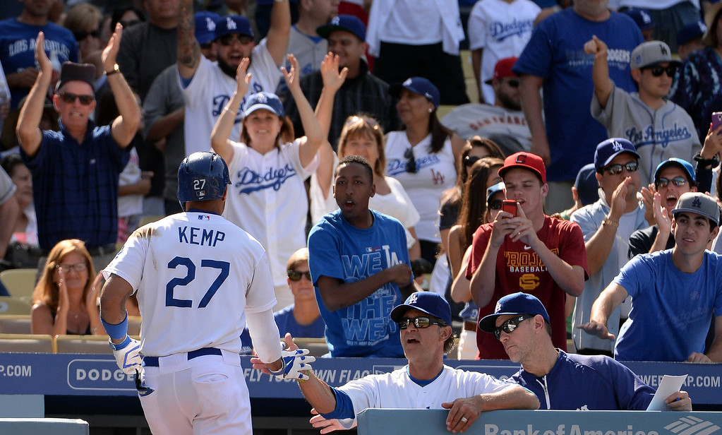 . Los Angeles Dodgers\' Matt Kemp high fives manager Don Mattingly after hitting a solo home run in the eighth inning during a Major league baseball game against the San Francisco Giants on Saturday, May 10, 2013 in Los Angeles.   (Keith Birmingham/Pasadena Star-News)
