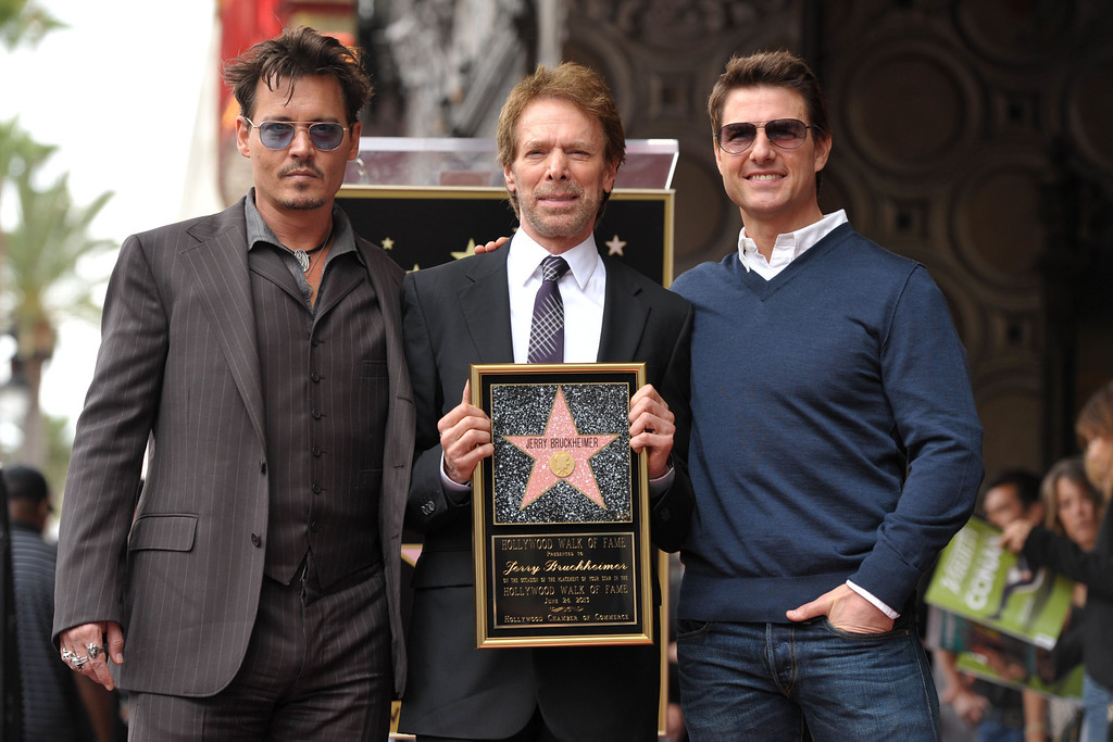 . Johnny Depp, from left, Jerry Bruckheimer, and Tom Cruise appear at a ceremony honoring Bruckheimer with a star on the Hollywood Walk of Fame on Monday, June 24, 2013 in Los Angeles. (Photo by John Shearer/Invision/AP)