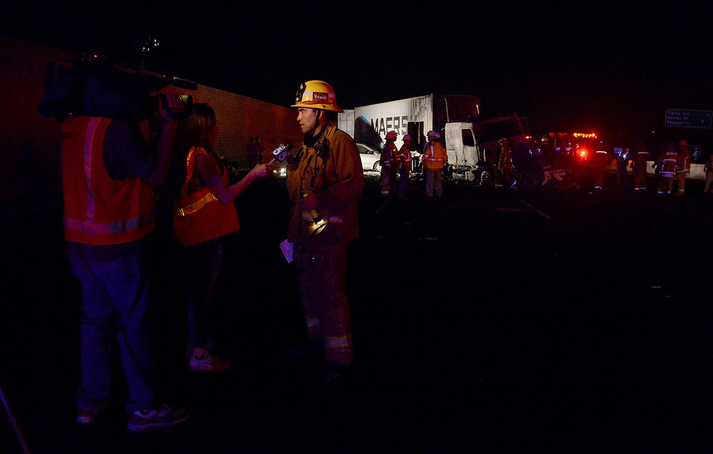 . LA County firefighters work the scene as CHP investigates a fatal traffic collision and fire involving a big rig Monday, August 19, 2013, on the eastbound lanes of the 10 freeway at Towne Ave in Pomona, CA. Jennifer Cappuccio Maher/Inland Valley Daily Bulletin