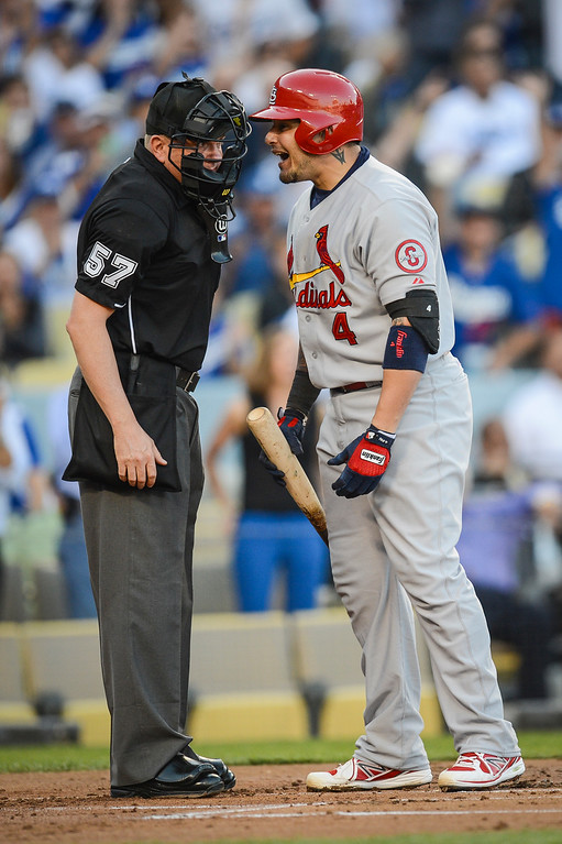 . Cardinals\' Yadier Molina argues the call with umpire Mkie Everitt at home plate in game 3 of the NLCS Monday October 14, 2013 ( Photo by Hans Gutknecht/Los Angeles Daily News )