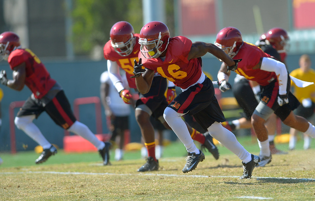 . USC football players work out during a practice at the Howard Jones Field at USC Monday August 19, 2013.  The Trojans start the season on August 29th with a game against Hawaii.(Andy Holzman/Los Angeles Daily News)