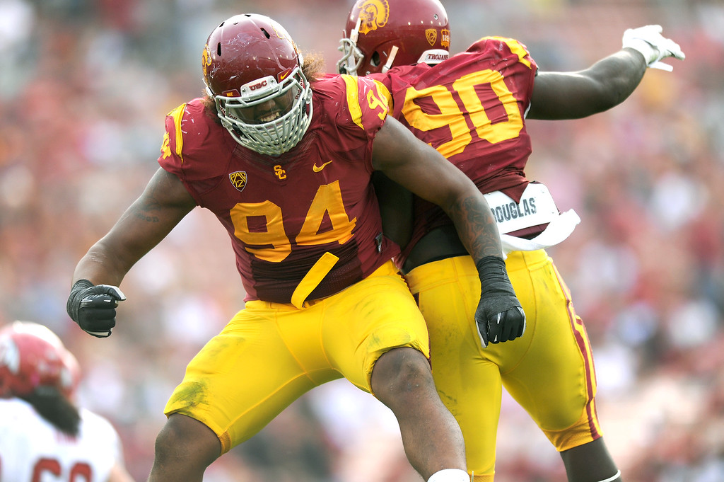 . USC\'s Leonard Williams, left, celebrates with George Uko after sacking Utah QB Adam Schulz in the fourth quarter, Saturday, October 26, 2013, at the L.A. Memorial Coliseum. (Michael Owen Baker/L.A. Daily News)