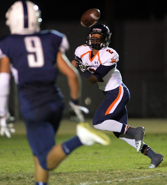. Chaminade High School\'s Jordan Athey #2 hauls in a long touchdown pass as Venice High School\'s Bryant Degrate #9 looks on during their game at Venice High School in Venice Thursday, August 28, 2014. (Photo by Hans Gutknecht/Los Angeles Daily News)