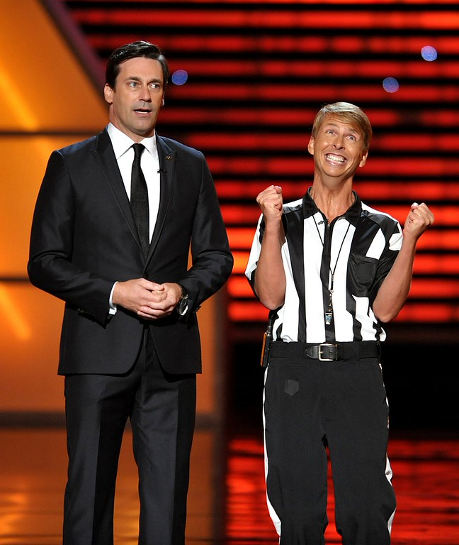 . Jon Hamm, left, and Jack McBrayer speak on stage at the ESPY Awards on Wednesday, July 17, 2013, at Nokia Theater in Los Angeles. (Photo by John Shearer/Invision/AP)