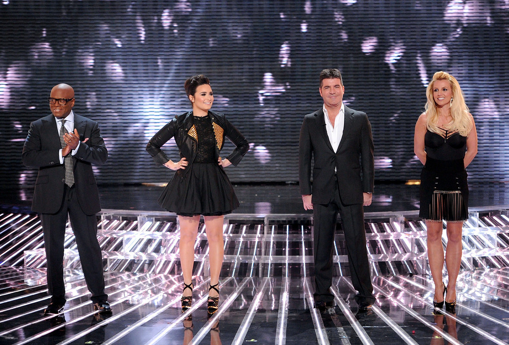 ". HOLLYWOOD, CA - NOVEMBER 28: (L-R) Judges L.A. Reid, Demi Lovato, Simon Cowell and Britney Spears onstage at FOX\'s ""The X Factor\"" Season 2 Top 8 Live Performance Show on November 28, 2012 in Hollywood, California. (Photo by Frank Micelotta/PictureGroup) via AP IMAGES"