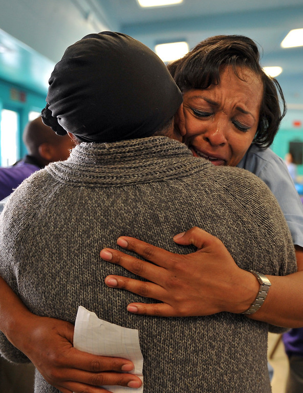 . 5/4/13 - Sequarier McCoy, of Los Angeles, hugs her mom, Erda McCoy who brought four of her children for a visit at the California Institution for Women. The mothers and children were united by the non-profit organization entitled Get On The Bus which provides an annual event of free transportation for the children and their caregivers to the prison. The visit becomes more of an event, with snacks, lunch, arts, crafts, photos, keepsakes and plenty of hugs and kisses. The program began in 2000 with one bus one prison and 17 kids. Today children are able to visit their mothers and fathers with 60 buses, seven prisons and more than a thousand kids. Photo by Brittany Murray / Staff Photographer