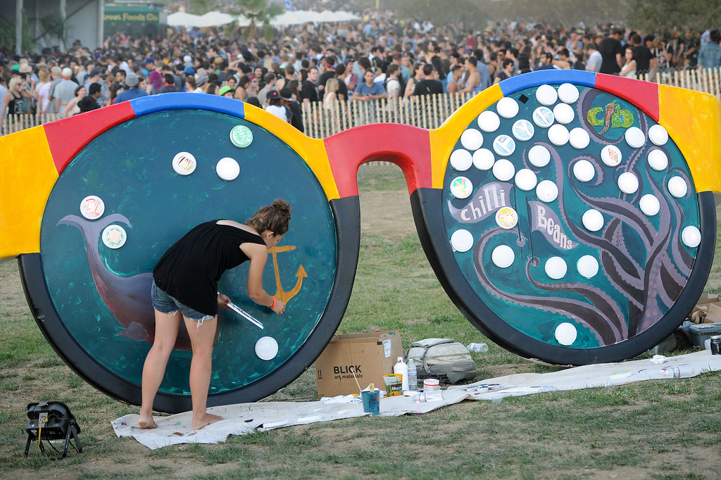 . A large pair of sunglasses gets painted at the FYF Fest in downtown L.A., Saturday, August 24, 2013. (Michael Owen Baker/L.A. Daily News)