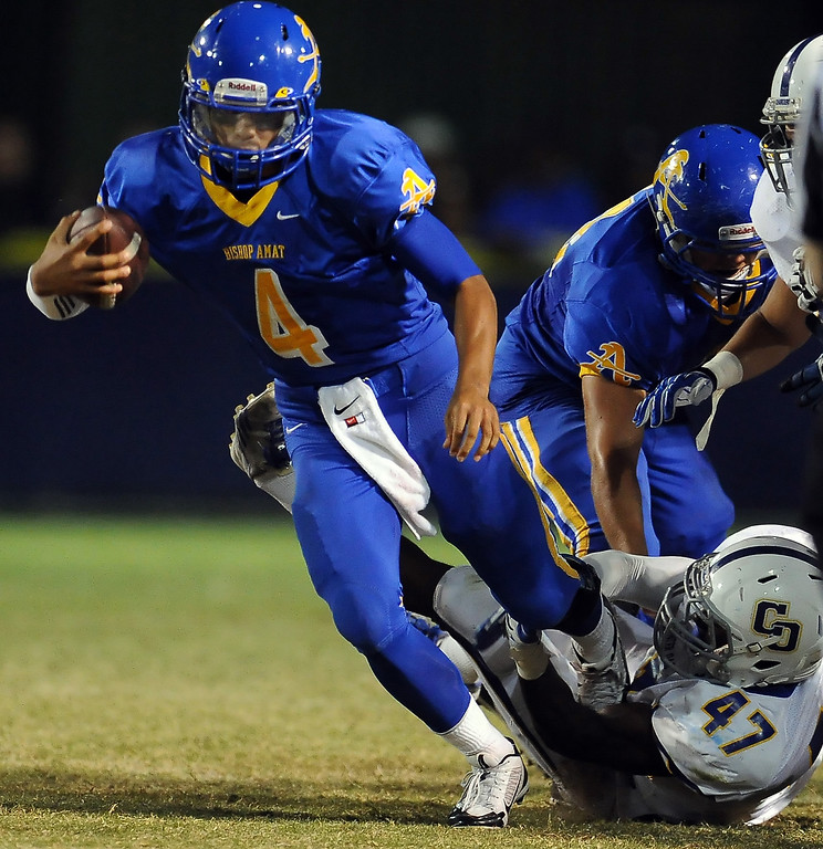 . Bishop Amat quarterback Koa Haynes (C) scrambles against Charter Oak in the first half of a prep football game at Bishop Amat High School in La Puente, Calif. on Friday, Sept. 20, 2013.    (Photo by Keith Birmingham/Pasadena Star-News)