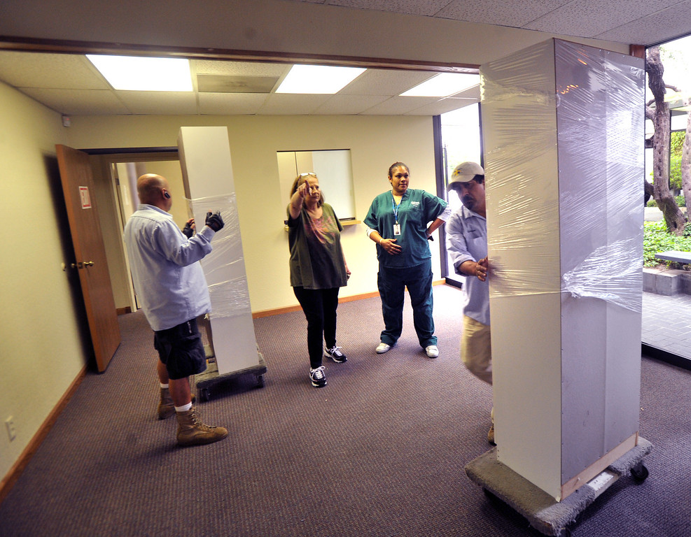. Movers carry in office furniture to the new location of the American Indian Healing Center at 7630 Painter Ave. in Whittier on Wednesday May 22, 2013. The medical clinic is increasing its space and is looking to bring other services to the clinic. (SGVN/Staff Photo by Keith Durflinger)