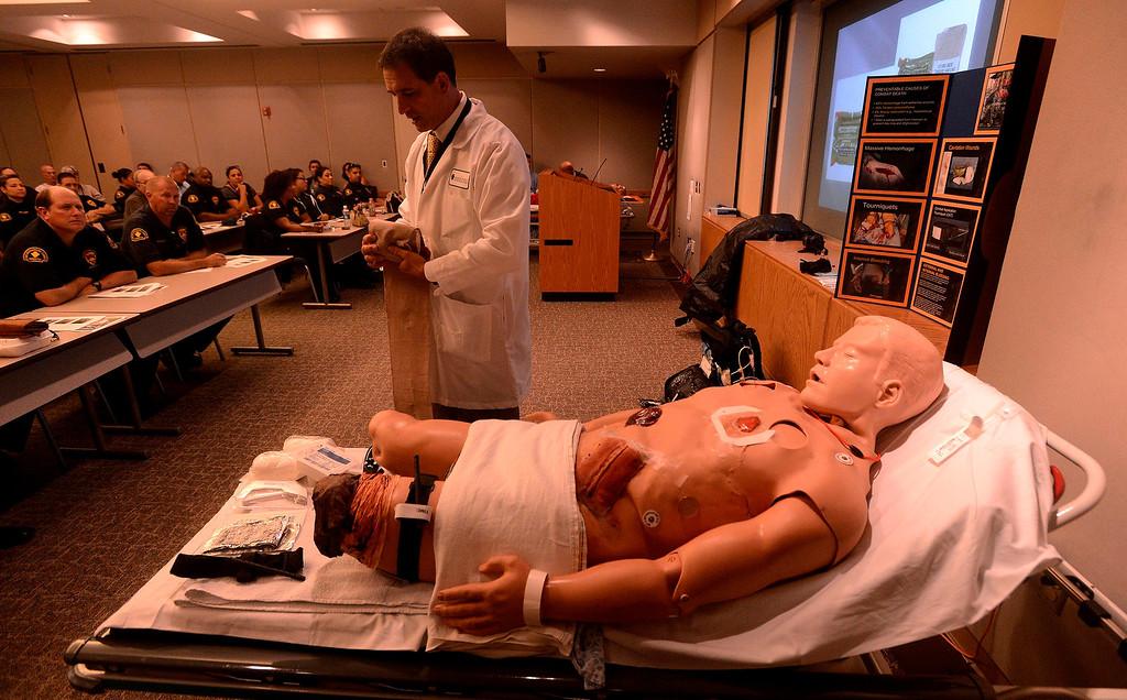 . Dr. Michael Neeki, educates San Bernardino County Probation officers during a trauma training seminar at Arrowhead Regional Medical Center in Colton August 22, 2013.   GABRIEL LUIS ACOSTA/STAFF PHOTOGRAPHER.