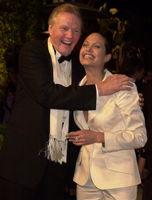 . Jon Voight and his daughter Angelina Jolie laugh at the Vanity Fair Oscar party at Morton\'s in Hollywood on March 25, 2001.  (AP Photo/Laura Rauch)