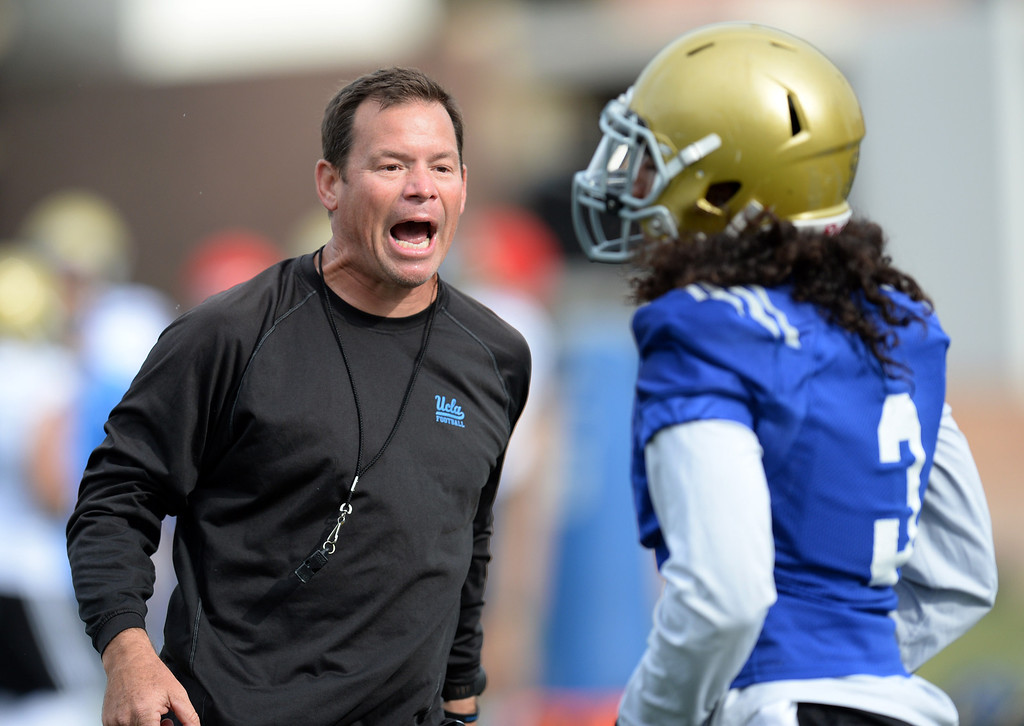 . UCLA head coach Jim Mora gets a point across to defensive back Randall Goforth after Goforth was involved in an altercation with another player during football practice at Spaulding Field on the UCLA campus Thursday, April 17, 2014. (Photo by Hans Gutknecht/Los Angeles Daily News)