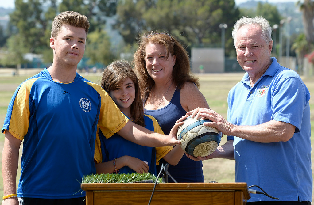. Rachel Timsit and her two kids Jordan and Hayley with Councilmember Tom LaBonge. LaBonge joined the Los Angeles Department of Recreation and Parks, LA Bureau of Engineering and a group of young soccer players to break ground on three new synthetic turf soccer fields at the Van Nuys Sherman Oaks Park. The $2.7-million renovation will include synthetic fields that can be used year round. Also planned are new paved walkways and benches. Sherman Oaks, CA. 7/1022014(Photo by John McCoy Daily News)