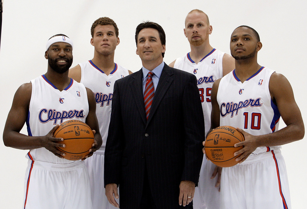 . Los Angeles Clippers coach Vinny Del Negro, center, poses with players, from left, Baron Davis, Blake Griffin, Chris Kaman and Eric Gordon during media day at the NBA basketball team\'s training center in Los Angeles on Monday, Sept. 27, 2010. (AP Photo/Reed Saxon)