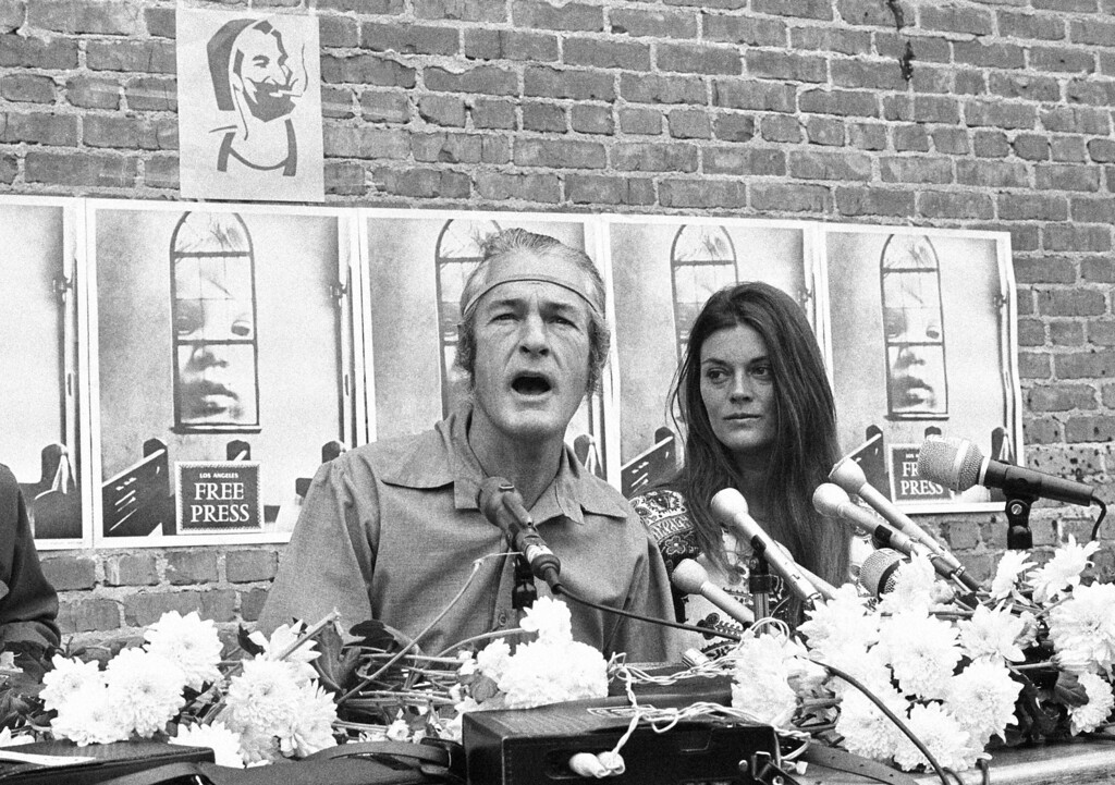 . Dr. Timothy Leary, with his wife Rosemary at his side, tells a press conference in Los Angeles, May 20, 1969 he plans to run for governor of California. Leary, a former Harvard professor and advocate of LSD, was granted a reversal of his marijuana conviction by the U.S. Supreme Court Monday. (AP Photo/David Smith)