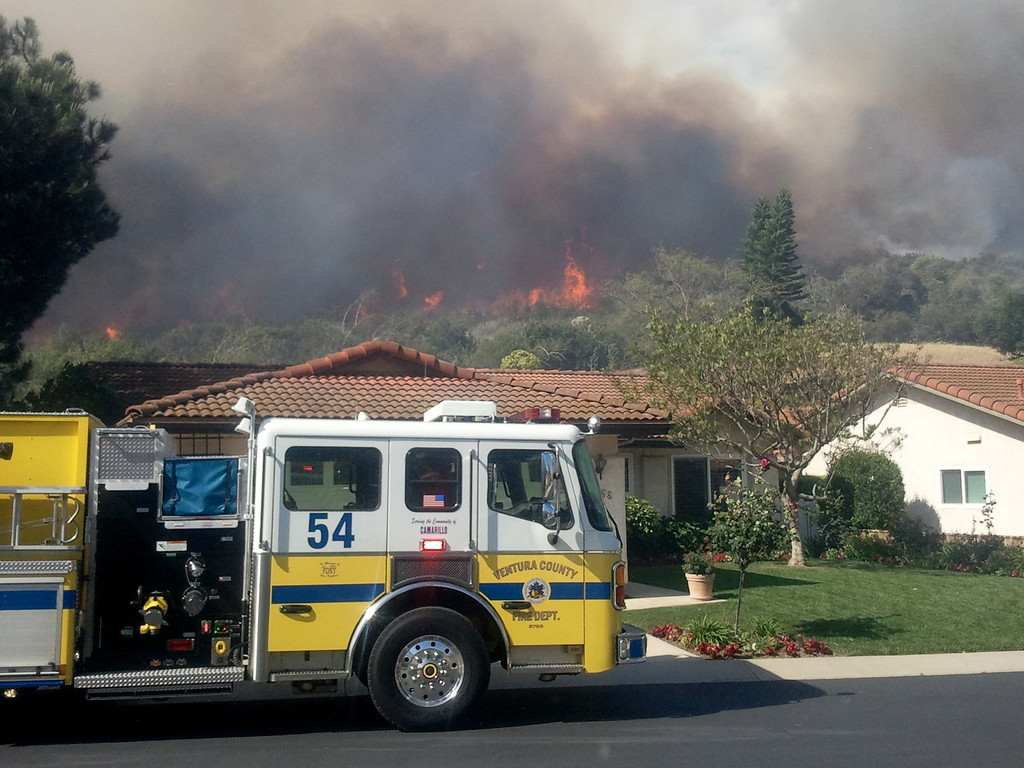 . A Ventura County fire truck is right near the Springs Fire on May 2, 2013, as the blaze threatens suburban homes near the Ventura (101) Freeway in Camarillo.  (Gene Blevins/Los Angeles Daily News)