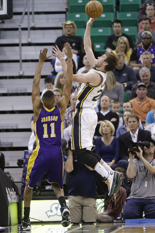 . Utah Jazz\'s Gordon Hayward, right, shoots as Los Angeles Lakers Wesley Johnson (11) defends in the first quarter during an NBA basketball game Monday, April 14, 2014, in Salt Lake City, Utah. (AP Photo/Rick Bowmer)