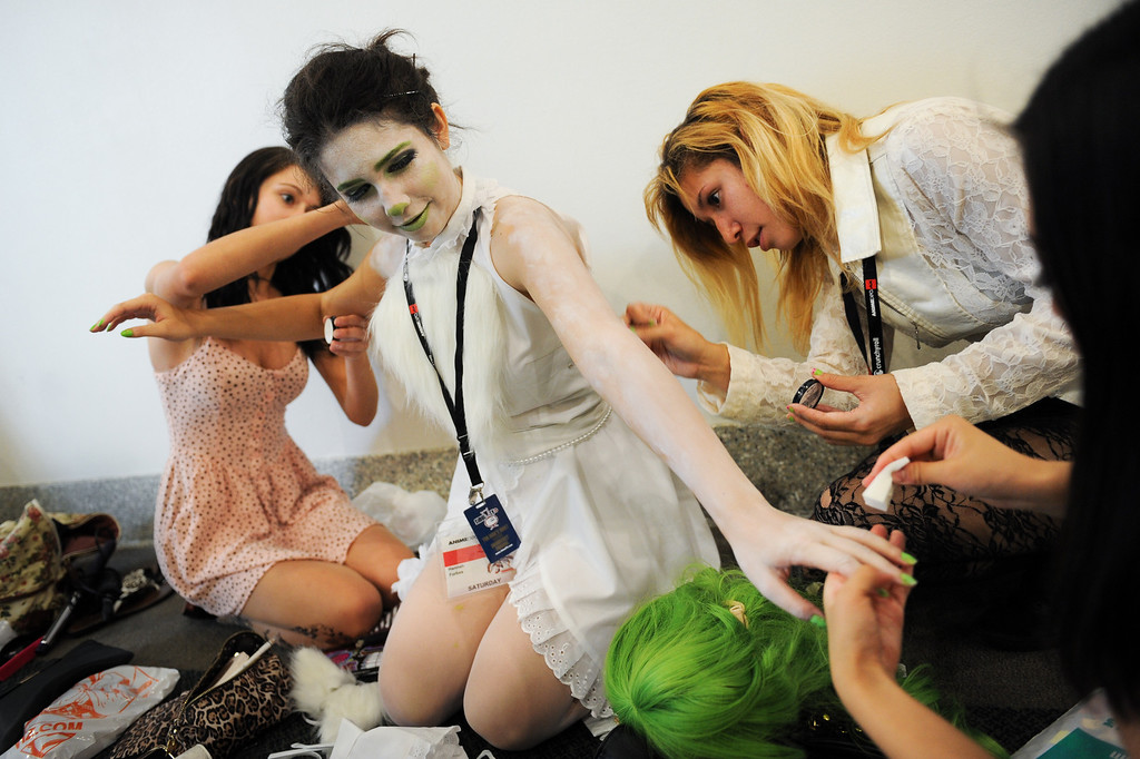 """. Hannah Forbes gets a make-up job from friends for her character \""""Jade Sprite\"""" at the Anime Expo at the L.A. Convention Center, Saturday, July 6, 2013. (Michael Owen Baker/L.A. Daily News)"""