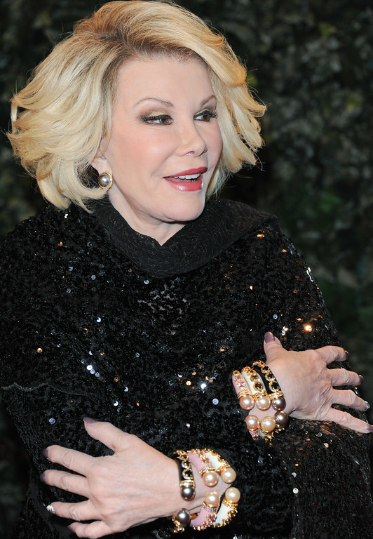 . Joan Rivers arrives at the QVC Red Carpet Style at the Four Seasons Hotel on Friday, Feb. 22, 2013 in Los Angeles. (Photo by Richard Shotwell/Invision/AP)
