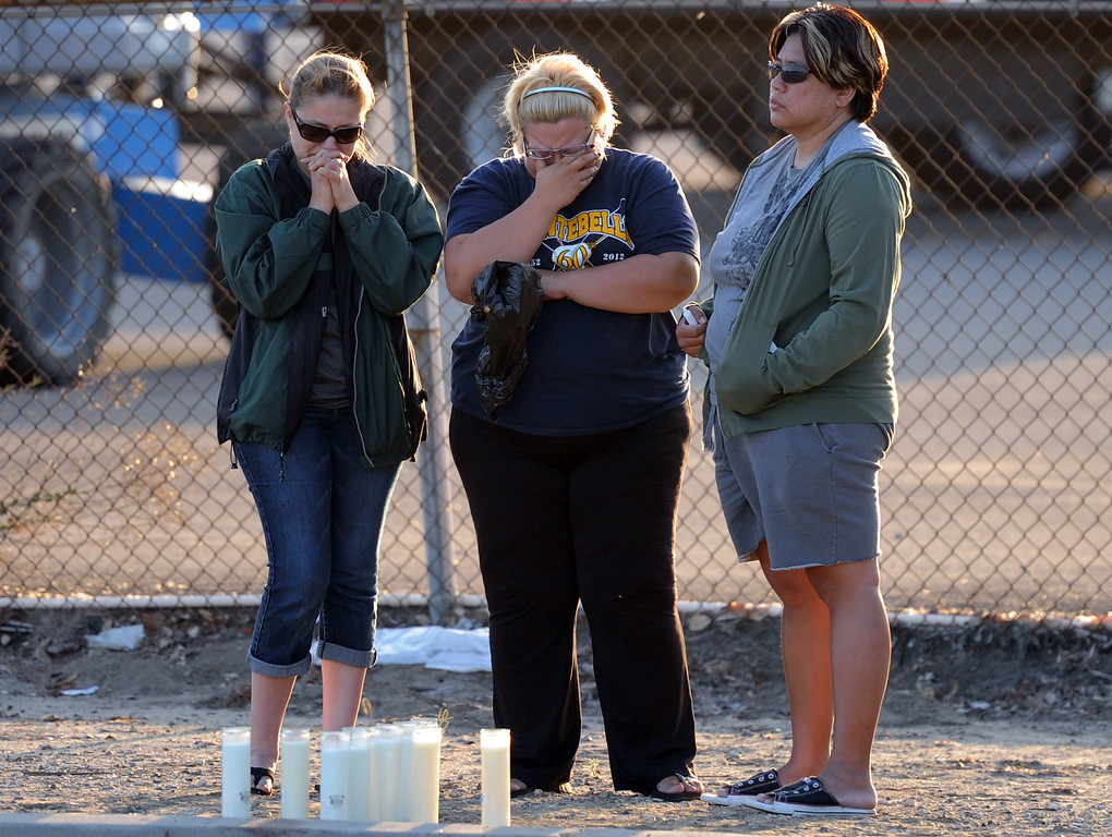 . Family and friends of the children who were killed grieve in front of a make shift memorial for a Man and two children who were killed in a late Thursday night crash along the 3500 block of San Gabriel River Road on Friday, June 14, 2013 in Industry, Calif. Three others were injured in the crash.  (Keith Birmingham/Pasadena Star-News)